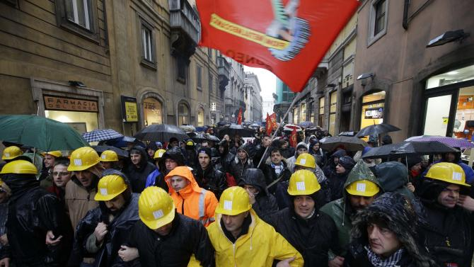 Ilva workers participate in a rally outside the Italian parliament, in Rome, Thursday, Nov. 29, 2012. Ilva, a steel plant in southern Italy at the center of an environmental scandal announced that it plans to close after police acting on prosecutors' warrants sequestered recent steel products bound for the market. Any closure would be a blow to the Italian government, which has been working to keep the Ilva steel plant operating while addressing health concerns amid reports of an elevated incidence of cancer in the area. (AP Photo/Andrew Medichini)