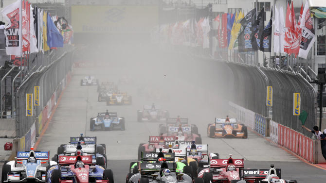 IndyCar driver Will Power, of Australia, right,  leads the pack during the start of the IndyCar Sao Paulo 300 in Sao Paulo, Brazil, Sunday, April 29, 2012. (AP Photo/Andre Penner)