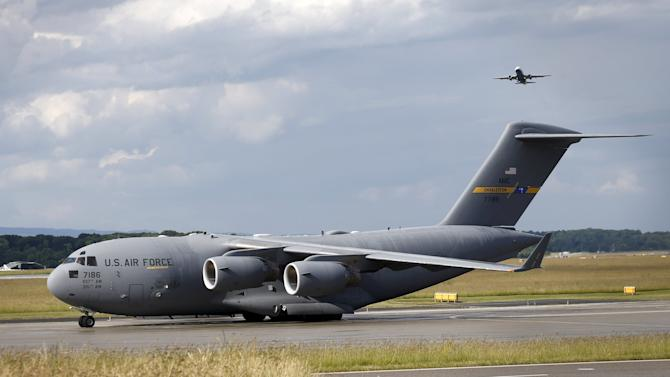A U.S. military C-17 aircraft taxi at Geneva airport to repatriate US Secretary of State Kerry in Geneva