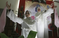 "In this Saturday, June 18, 2011 photo, Muslim dancers perform during the launching ceremony of ""Klub Taat Suami,"" or ""Obedient to Husband Club,"" at a restaurant In Jakarta, Indonesia. The new club that aims to encourage women to be pious and totally obedient to their husbands has generated an outcry from some activists. (AP Photo/Dita Alangkara)"