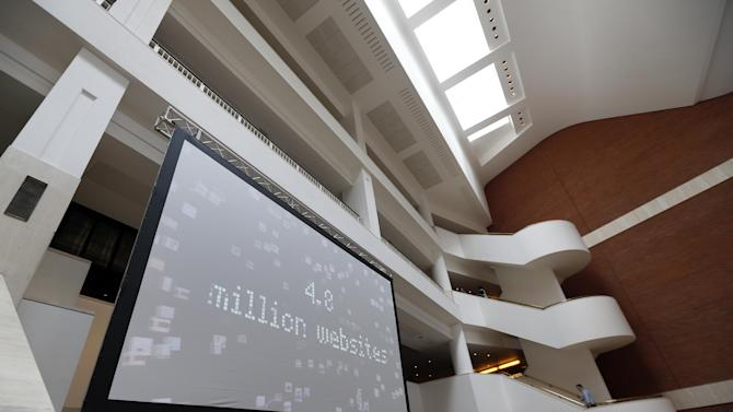 """In this photo taken Wednesday, April 3, 2013, a screen showcasing the British Library latest task is seen in London. Capturing the unruly, ever-changing Internet is like trying to pin down a raging river. But the British Library is going to try. For centuries the library has preserved a copy of every book, pamphlet, magazine and newspaper published in Britain. Starting Saturday, April 6, 2013, it will also be bound to record every website, e-book and blog, in a bid to preserve the nation's """"digital memory."""" (AP Photo/Lefteris Pitarakis)"""