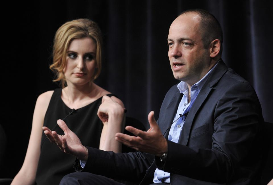 "Gareth Neame, right, executive producer of the Masterpiece series ""Downton Abbey,"" addresses a reporter as cast member Laura Carmichael looks on during the PBS Summer 2013 TCA press tour at the Beverly Hilton Hotel on Tuesday, Aug. 6, 2013 in Beverly Hills, Calif. (Photo by Chris Pizzello/Invision/AP)"