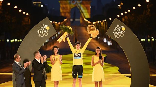 Christopher Froome, winner of the centenary Tour de France cycling race, celebrates his overall victory on the podium after the 133.5km final stage, from Versailles to Paris Champs Elysees, July 21, 2013