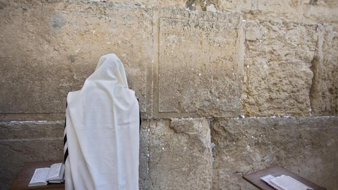 An ultra-Orthodox Jewish man prays at the Western Wall,  the holiest site where Jews can pray in Jerusalem's old city, Wednesday, Sept. 17, 2014. (AP Photo/Sebastian Scheiner)