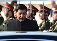 Pakistan's Prime Minister Raja Ashraf, pictured at Wattay airport in Laos on November 4, 2012. Pakistan's top judge has ordered the arrest of the prime minister over alleged corruption in power projects, a move which could worsen the country's political turmoil