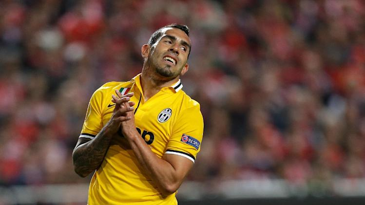 FILE - In this April 24, 2014 file photo, Juventus' Carlos Tevez reacts after missing a chance to score during a Europa League soccer semifinal at Benfica's Luz Stadium in Lisbon, Portugal. Tevez's father was kidnapped after his vehicle was intercepted Tuesday, July 29, 2014, outside Argentina's capital Buenos Aires, said the footballer's lawyer, Gustavo Galasso. (AP Photo/Armando Franca, File)