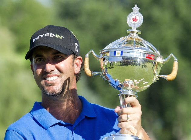Scott Piercy holds the championship trophy after winning the Canadian Open at the Hamilton Golf and County Club in Ancaster, Ontario, on Sunday, July 29, 2012. (AP Photo/The Canadian Press, Nathan Denette)