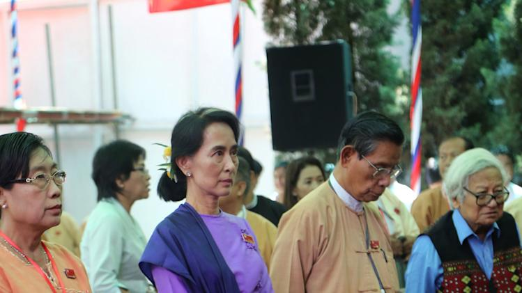 Myanmar's opposition leader Aung San Suu Kyi, center, and senior leaders of her National League for Democracy party attend the second day session of first ever congress of her National League for Democracy party at Royal Rose restaurant in Yangon, Myanmar, Sunday, March 10, 2013. Suu Kyi has been elected head of the new executive board of Myanmar's opposition National League for Democracy, as the party has a makeover to adjust itself to the country's new democratic framework. (AP Photo/Khin Maung Win)
