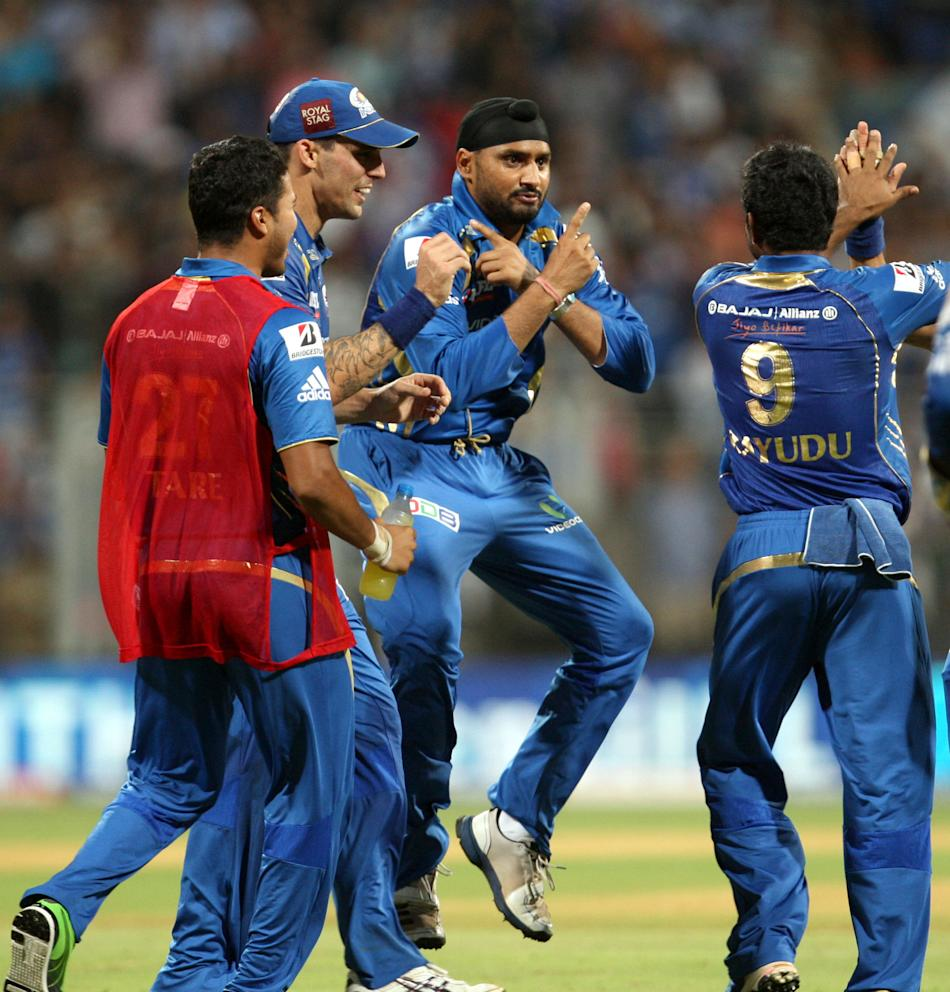 Mumbai Indians bowler Harbhajan Singh breaks into Gangnam Style dance after getting the wicket of Chris Gayle during the match between Mumbai Indians and Royal Challengers Bangalore at Wankhede Stadiu