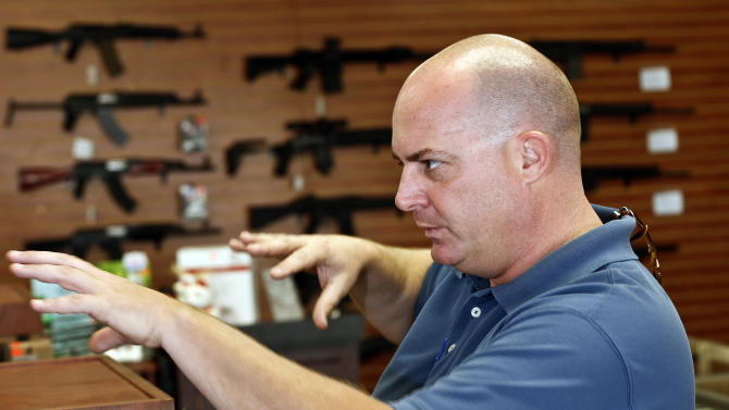 Former Tucson mayoral candidate Shaun McClusky talks about the privately funded program he is launching to provide residents in crime-prone areas with free shotguns so they can defend themselves against criminals, Thursday, March 28, 2013, in Tucson, Ariz. (AP Photo/Ross D. Franklin)