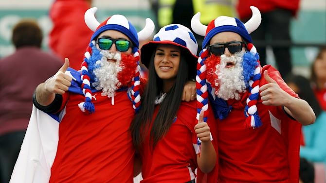 Fans of Chile cheer before their team's 2018 World Cup qualifying soccer match against Brazil at the Nacional Julio Martinez stadium in Santiago