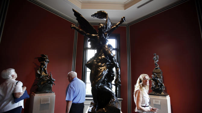 Guest view the newly restored interior of the Rodin Museum, Thursday, July 12, 2012, in Philadelphia. For the first time since the museum opened in 1929, the public will get to see it as its architects intended. The Rodin Museum reopens Friday after a more than three-year, $9 million renovation that returned all its sculptures to their original locations inside and out, refurbished almost all of them.  (AP Photo/Brynn Anderson)
