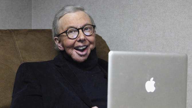 FILE - In this Jan. 12, 2011 file photo, Pulitzer Prize-winning movie critic Roger Ebert works in his office at the WTTW-TV studios in Chicago. Ebert died on Thursday, April 4, 2013. He was 70. Ebert started out as an old-school newspaper man, the kind that has all but vanished: a fierce competitor who spent the day trying to scoop the competition and the night bellied up to the bar swapping stories. Then newspapers fell on hard times, either laying off huge chunks of their staffs or disappearing altogether. But Ebert didn't merely survive. He flourished, largely by embracing television and later the Internet and social networks. (AP Photo/Charles Rex Arbogast, File)