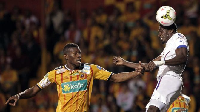Brown of Costa Rica's Herediano fights for the ball with Estupinan of Honduras' Olimpia during their CONCACAF Champions League soccer match in Heredia