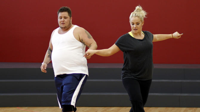 "Chaz Bono, left, and Lacey Schwimmer practice dance steps while rehearsing for the upcoming season of ""Dancing of the Stars"" in Los Angeles, Wednesday, Sept. 7, 2011.   The new season of ""Dancing with the Stars"" premieres Sept. 19 on ABC. (AP Photo/Matt Sayles)"