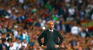 Bayern Munich's coach Guardiola reacts during the Champions League semi-final first leg soccer match against Real Madrid at Santiago Bernabeu stadium in Madrid