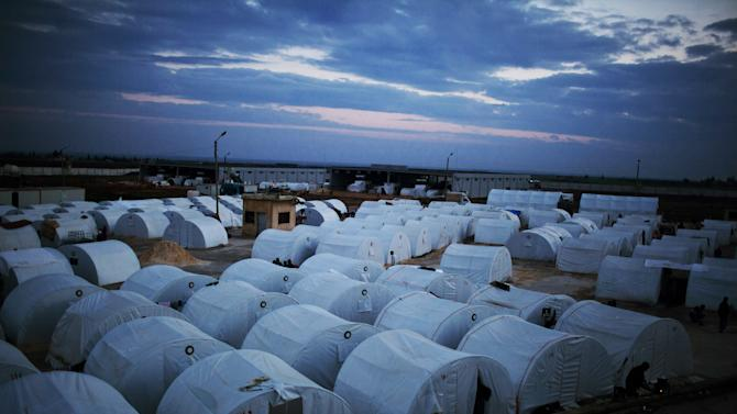 General view of a refugee camp near the Turkish border, in Azaz, Syria, Sunday, Dec. 9, 2012. (AP Photo/Manu Brabo)