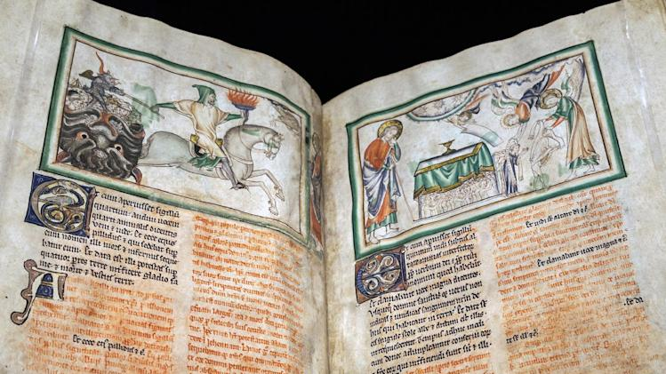 "In this photo taken Tuesday, May 29, 2012, A medieval manuscript : ""Opening the Fourth Seal; The Fourth Horseman"" by an unknown artist, London, about 1255-60, is displayed at the ""Heaven, Hell and Dying Well: Images of Death in the Middle Ages"" exhibit at The Getty Museum in Los Angeles. The show goes back to the 15th century to unearth some of the mankind's earliest, most colorful images of life's final chapter. In chapter six of the Apocalypse, Saint John the Evangelist described his vision of the four horsemen who herald the coming of the Last Judgment. (AP Photo/Damian Dovarganes)"