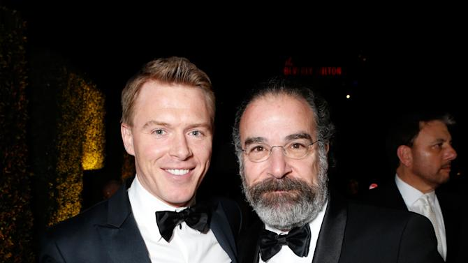 Actors Diego Klattenhoff, left, and Mandy Patinkin attend the Fox Golden Globes Party on Sunday, January 13, 2013, in Beverly Hills, Calif. (Photo by Todd Williamson/Invision for Fox Searchlight/AP Images)