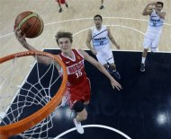 Russia&#39;s Andrei Kirilenko (15) drives to the basket against Argentina during a men&#39;s bronze medal basketball game at the 2012 Summer Olympics, Sunday, Aug. 12, 2012, in London. (AP Photo/Eric Gay, pool)