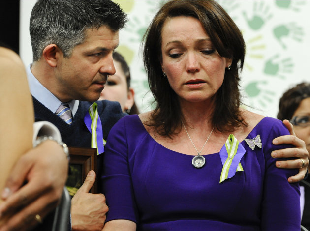 Ian and Nicole Hockley, parents of Sandy Hook School shooting victim Dylan, listen at a news conference at Edmond Town Hall in Newtown, Conn., Monday, Jan. 14, 2013. One month after the mass school sh
