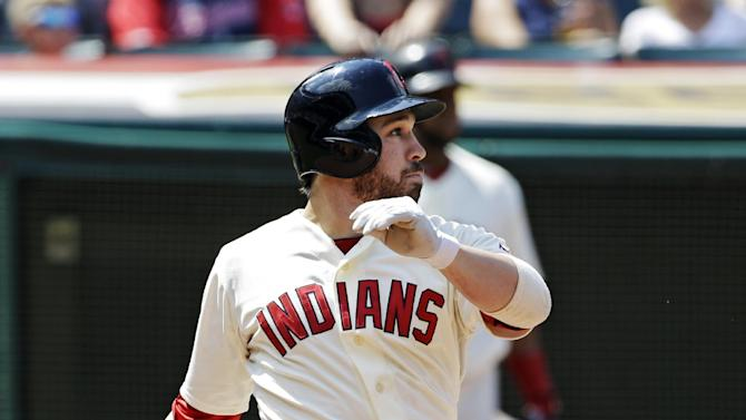 Cleveland Indians' Jason Kipnis singles to drive in a run against the Minnesota Twins in the third inning of a baseball game on Sunday, Aug. 25, 2013, in Cleveland. (AP Photo/Mark Duncan)