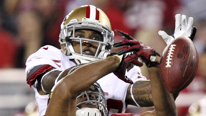 San Francisco 49ers defensive back Chris Culliver breaks up a pass intended for Arizona Cardinals wide receiver Larry Fitzgerald (11) during the first half of an NFL football game, Monday, Oct. 29, 2012, in Glendale, Ariz. (AP Photo/Paul Connors)