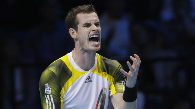 Andy Murray of Britain reacts to a point lost to Novak Djokovic of Serbia during their ATP World Tour Finals singles tennis match at the O2 Arena in London, Wednesday, Nov. 7, 2012. (AP Photo/Sang Tan)
