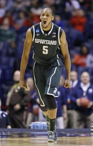 Michigan State forward Adreian Payne (5) reacts during the first half of a regional semifinal against Duke in the NCAA college basketball tournament, Friday, March 29, 2013, in Indianapolis. (AP Photo/Darron Cummings)