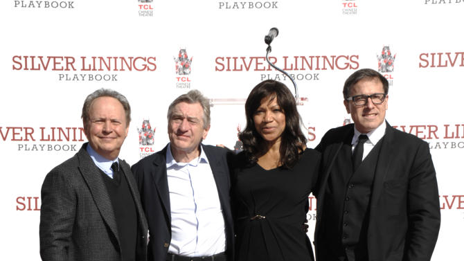 IMAGE DISTRIBUTED FOR TCL CHINESE THEATRE - From left, actor Billy Crystal, actor Robert De Niro, Grace Hightower, and director David O. Russell pose together at De Niro's hand and footprint ceremony at the TCL Chinese Theatre in Los Angeles on Monday, Feb. 4, 2013. (Photo by Dan Steinberg/Dan Steinberg Photography for TCL Chinese Theatre/AP Images)