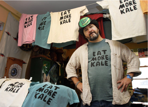 "FILE-  In this Nov. 22, 2011 file photo, Bo Muller-Moore stands in his home studio in Montpelier, Vt. Muller-Moore, the Vermont man who is building a business around the term ""eat more kale,"" which ha"