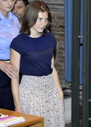 Amanda Knox arrives in court for her appeal trial in Perugia, Italy, Saturday, June 18, 2011. Knox was convicted of murdering her British roommate in Perugia, Meredith Kercher, and sentenced to 26 years in prison. Her co-defendant and ex-boyfriend Raffaele Sollecito was also convicted and sentenced to 25 years. They both deny wrongdoing and have appealed the 2009 verdict. (AP Photo/Stefano Medici)