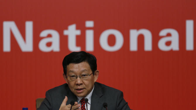 Chinese Commerce Minister Chen Deming speaks at a press conference during the 18th Communist Party Congress in Beijing Saturday, Nov. 10, 2012. (AP Photo/Vincent Yu)