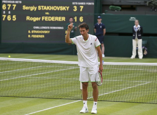 Sergiy Stakhovsky of Ukraine reacts after defeating Roger Federer of Switzerland in their men's singles tennis match at the Wimbledon Tennis Championships, in London
