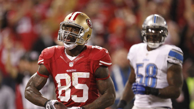 FILE - This Sept. 16, 2012 file photo shows San Francisco 49ers tight end Vernon Davis, left, reacting after scoring a touchdown during the fourth quarter of an NFL football game against the Detroit Lions in San Francisco. At right is Detroit Lions linebacker Ashlee Palmer. Davis might get fewer style points these days for his touchdown celebrations _ and he's perfectly fine with that.  (AP Photo/Tony Avelar, File)