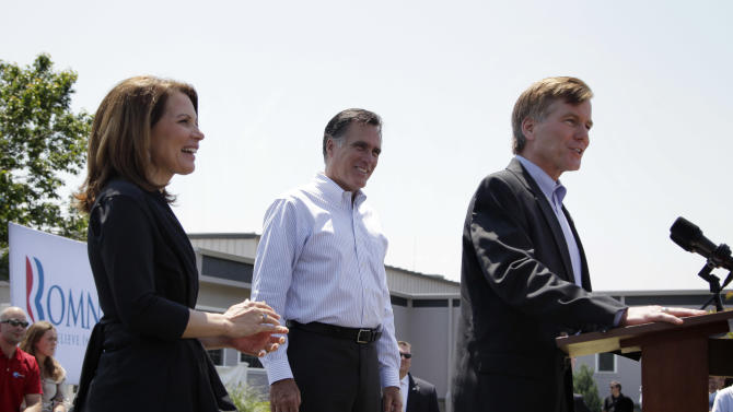 Republican presidential candidate, former Massachusetts Gov. Mitt Romney, center, and Rep. Michele Bachmann, R-Minn., left, listen as Virginia Gov. Bob McDonnell speaks at a campaign stop in Portsmouth, Va., Thursday, May 3, 2012. (AP Photo/Jae C. Hong)