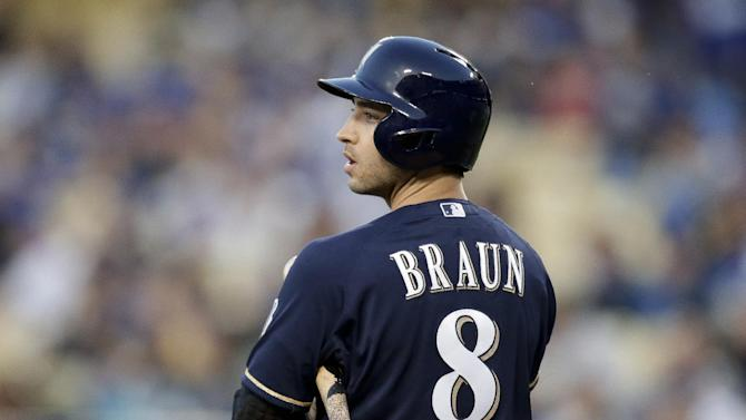 FILE - In this April 26, 2013 file photo, Milwaukee Brewers' Ryan Braun gets ready to bat during a baseball game against the Los Angeles Dodgers in Los Angeles. A person familiar with the case tells The Associated Press Tuesday June 4, 2013 that the founder of a Miami anti-aging clinic has agreed to talk to Major League Baseball about players linked to performance-enhancing drugs. Alex Rodriguez, Ryan Braun, Nelson Cruz and Melky Cabrera are among the players whose names have been tied to the clinic.  (AP Photo/Jae C. Hong, File)