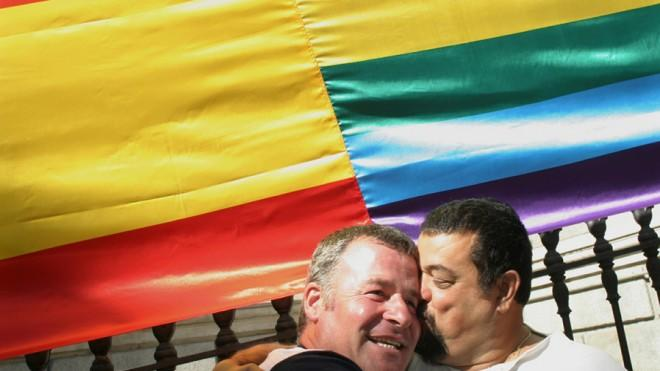 A couple embraces outside Spain's parliament in Madrid after same-sex marriage is legalized on June 30, 2005.