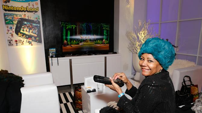 Actress Tonya Pinkins warms up and checks out Wii U at the Nintendo Lounge while playing Nintendo Land during a break from the Sundance Film Festival on Saturday, January 19, 2013 in Park City, UT. (Photo by Todd Williamson/Invision for Nintendo/AP Images)