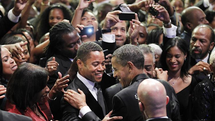 President Barack Obama greets actor Cuba Gooding at the Congressional Black Caucus Foundation Foundation Annual Phoenix Awards in Washington Saturday Sept. 24, 2011. (AP Photo/Manuel Balce Ceneta)