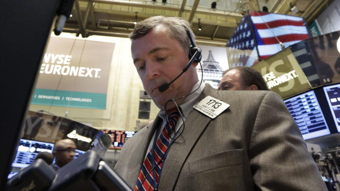 Trader James Lamb works on the floor of the New York Stock Exchange Tuesday, March 19, 2013. A surprisingly strong increase in new home construction is sending stocks higher in early trading on Wall Street. (AP Photo/Richard Drew)