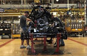 Ford Motor auto assembly workers install an EcoBoost fuel efficient engine in the chassis of a 2014 F-150 pick-up truck at the Dearborn Truck Plant in Dearborn, Michigan
