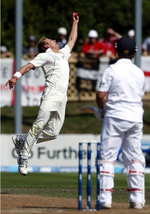 New Zealand's Wagner jumps to take a catch to dismiss England's Trott during the fifth day of the first test in Dunedin