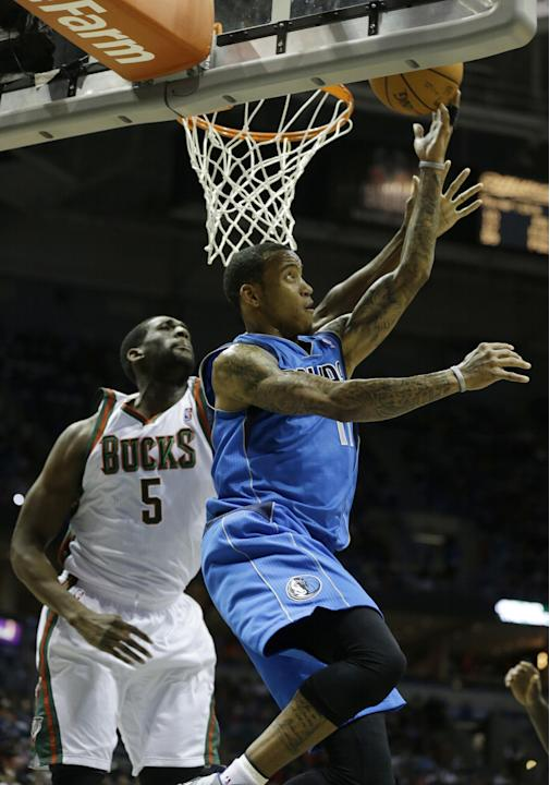 Dallas Mavericks' Monta Ellis, right, drives past Milwaukee Bucks' Ekpe Udoh during the first half of an NBA basketball game Saturday, Nov. 9, 2013, in Milwaukee
