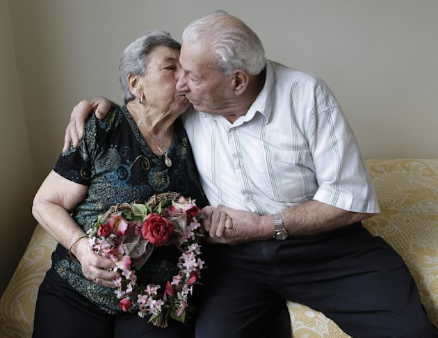 Madalena, 88, and Fortunato Corso, 89, a Bensonhurst couple married 72 years prepare for Valentine's Day with a kiss at home in New York, Wednesday, Feb. 13, 2013.  On Thursday they'll be honored by B