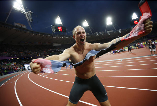 Germany's Robert Harting celebrates after winning the men's discus throw final at London 2012 Olympic Games
