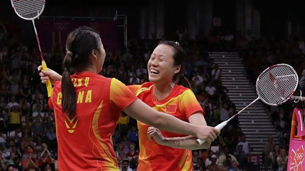 China's Zhao Yunlei and Tian Qing (L) celebrate winning their women's doubles badminton gold medal match against Japan's Mizuki Fujii and Reika Kakiiwa at the London 2012 Olympic Games (Reuters)