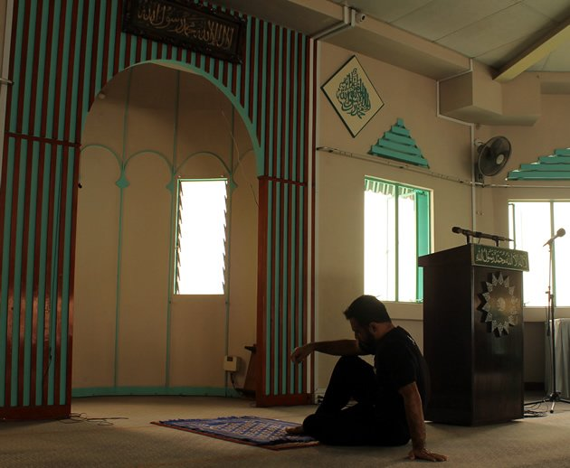Bashir Ahmad dwells in the austerity of a mosque, in preparation for his ONE FC fight this Friday. (Yahoo Photo)