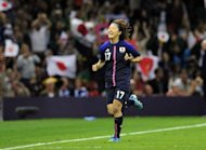 Japan's striker Yuki Ogimi celebrates scoring the opening goal during their London 2012 Olympic Games women's quarter-final football match against Brazil at the Millennium Stadium in Cardiff, Wales. World champions Japan ended Brazil's quest for a first Olympic women's football title with a 2-0 quarter-final win