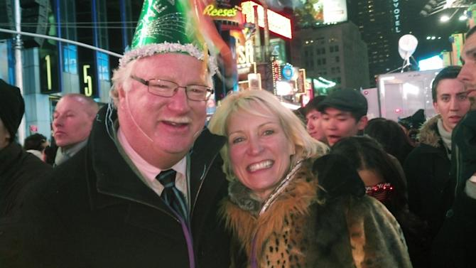 CORRECTS SPELLING OF HALVERSON'S FIRST NAME - Yvonne Gomez, 53, a physician from Grand Forks, N.D., right, and her husband, 63-year-old potato farmer Gregg Halverson pose in New York's Times Square shortly after midnight Jan. 1, 2013. (AP Photo/Verena Dobnik)